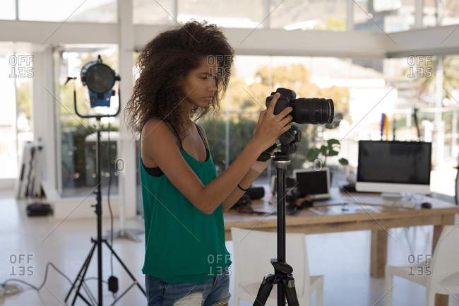 Beautiful Photographer Taking Pictures In The Studio Stock Photo