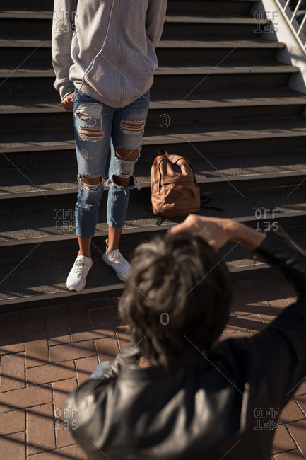 Photographer taking pictures of a model in street on a sunny day