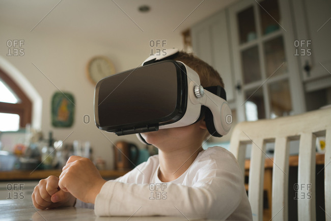 Close-up of male child experiencing virtual reality headset in kitchen at home