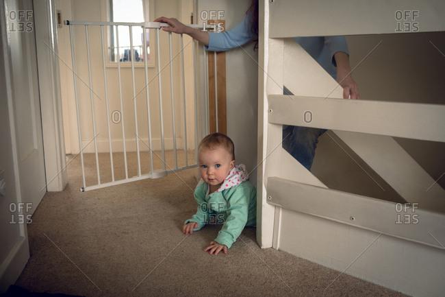 Adorable baby girl crawling at home