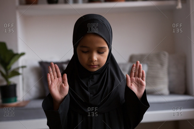 Muslim girl praying salah at home