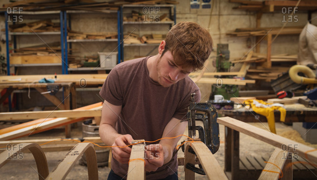 Young male carpenter working in workshop