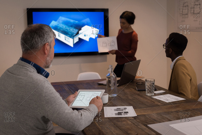 Executive giving a presentation in the meeting room at creative office