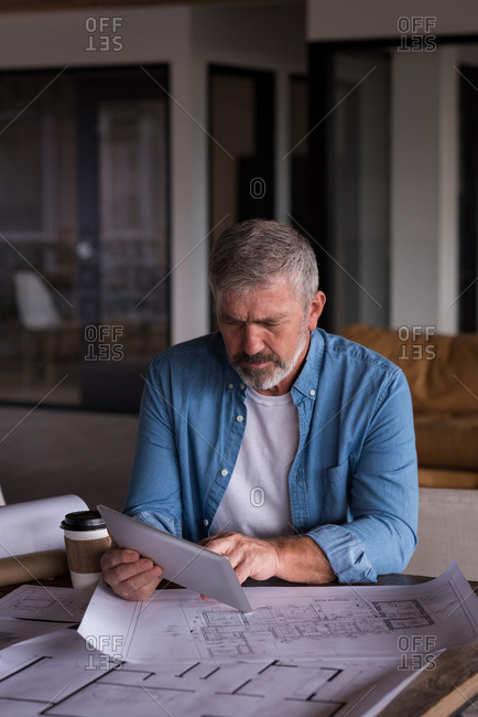 Concentrated office executive using table at creative office