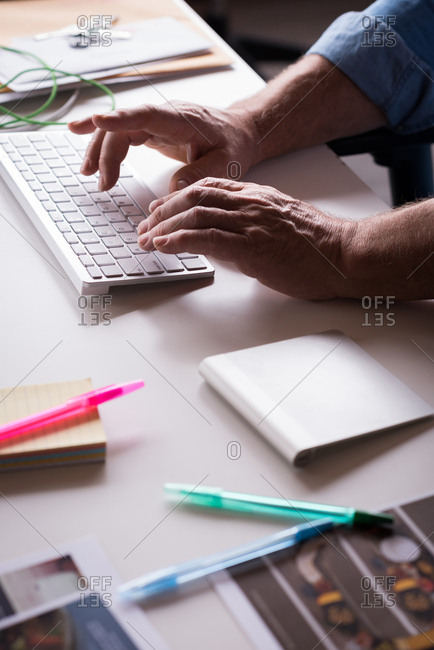 Close-up of businessman typing on the keyboard at desk
