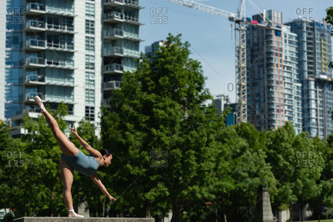 Young female ballet dancer dancing in the city