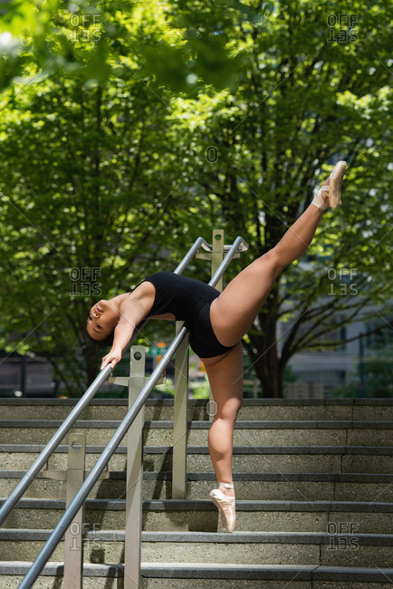 Beautiful female ballet dancer dancing on the steps