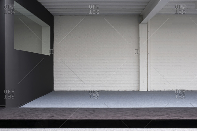 White brick wall inside showroom