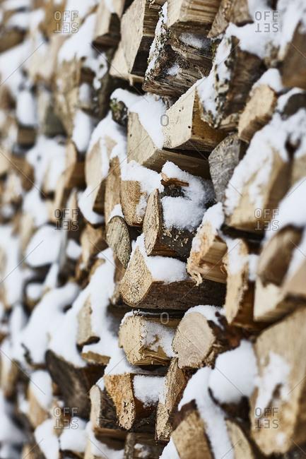 Firewood pile, winter, snow, detail, blur