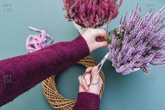 DIY, woman, detail, hands, autumnal decoration, willow wreath, heather