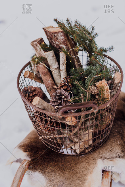 Sledge with fur and a basket of firewood and fairy lights,
