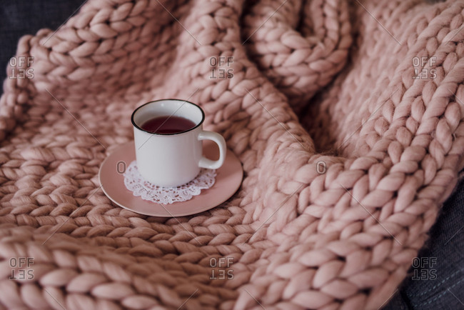 Sofa with blanket and teacup, detail,