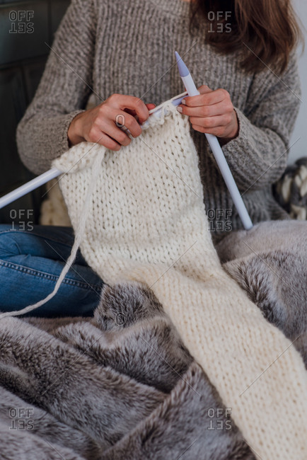Young woman knits, detail, hands,