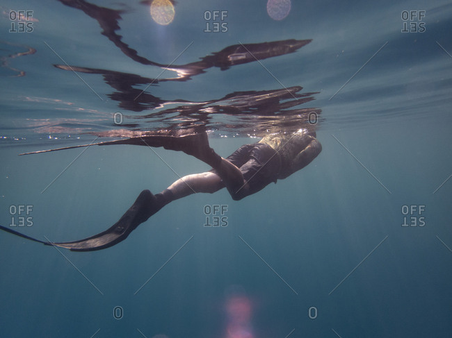 Free diver swimming to surface