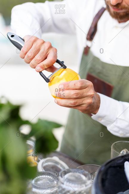Man peeling an orange