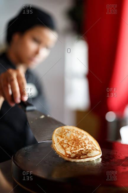 Chef flipping a pancake