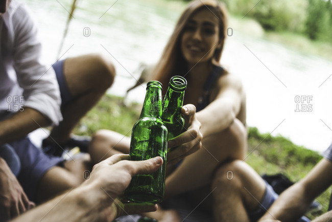 Young women drinking beer together