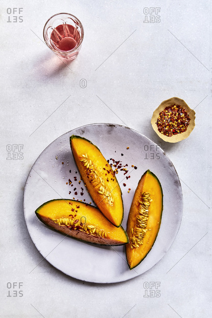 Melons with chilli flakes and rose