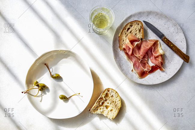Mediterranean Dinner of parma ham, bread and capers