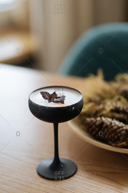 Foamy cocktail in black stemware