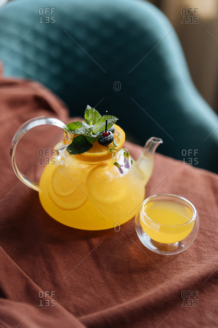 Yellow cocktail in glass kettle