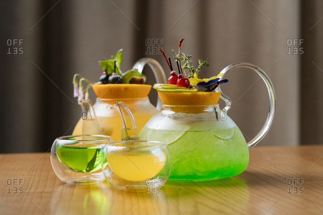 Colorful cocktails in glass kettles