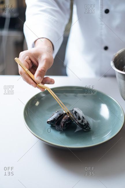 Chef preparing mussel dish