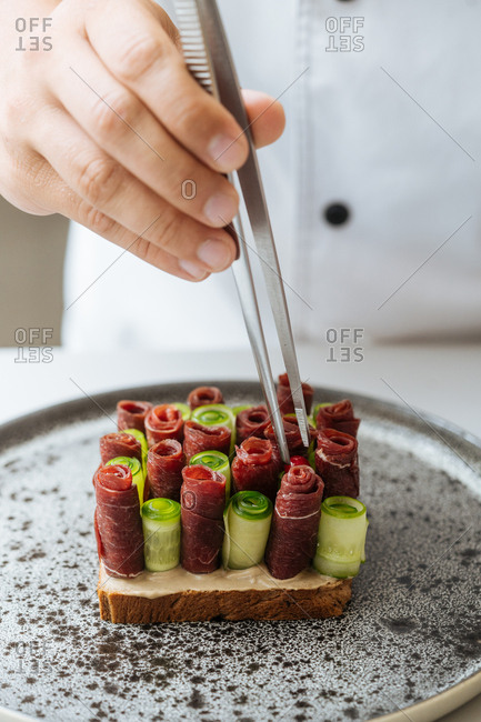 Close up of chef preparing gourmet dish in a restaurant
