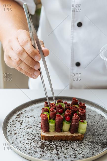Close up of chef preparing gourmet dish