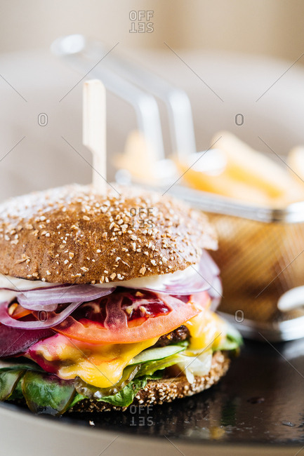 Close up of cheeseburger and fries served in a restaurant