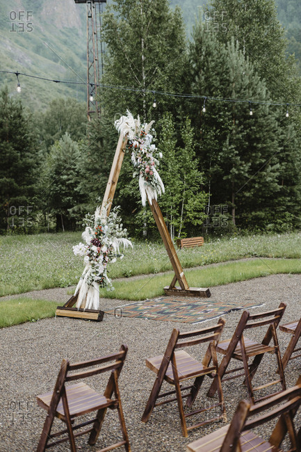 Wooden a-frame alter at a country wedding ceremony