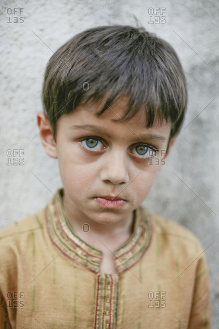 Portrait of a boy with blue eyes in India