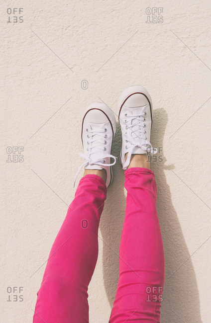 Woman with canvas shoes and pink jeans, Ideal fashion for spring and summer days