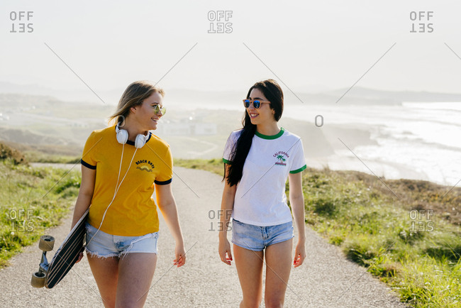 Stylish confident girls in summertime