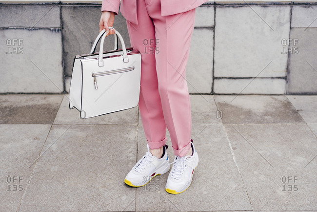Crop stylish model in sneakers and suit