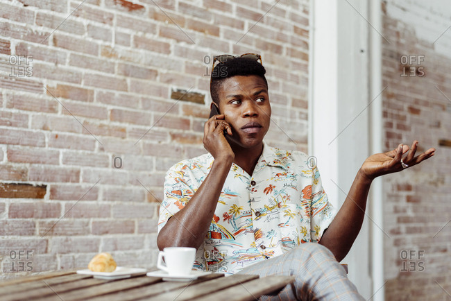 Man using smartphone during breakfast