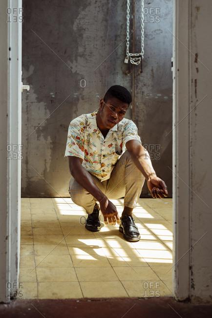 Stylish man posing near door