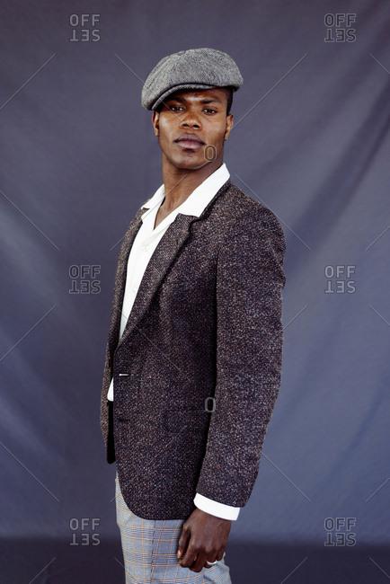Stylish black man posing in studio