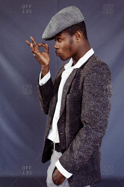 Stylish black man posing in studio