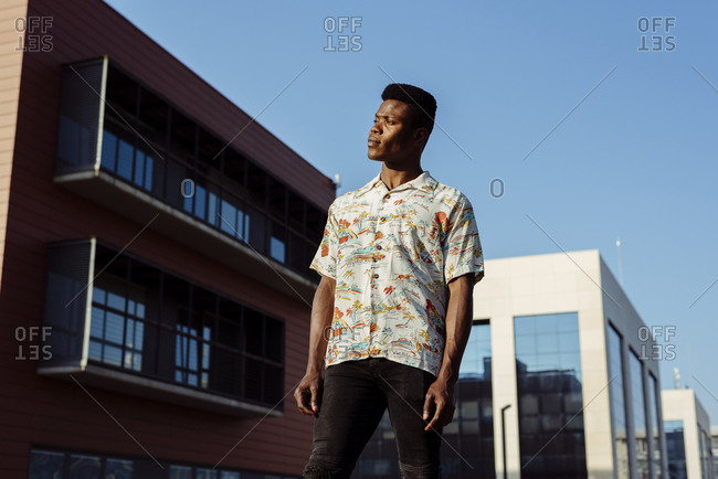 Stylish black man standing on street