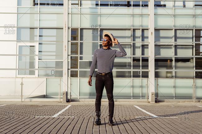 Stylish black man posing on street