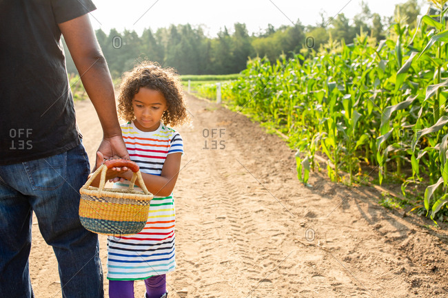 Father and daughter on a U-pick farm
