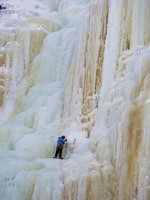 Man Ice Climbing In Finland