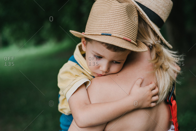 Young 3-year-old boy hugging his mother