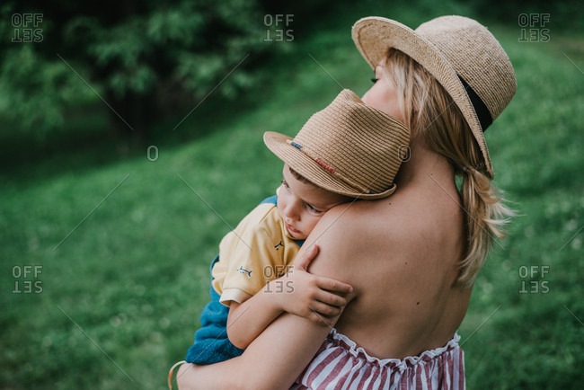 Little boy rest in his mothers arms