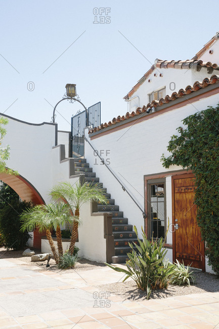 Staircase and door along exterior of Spanish style house