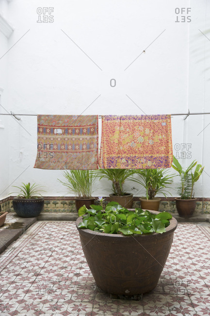 Hanging textiles and potted plants on patio