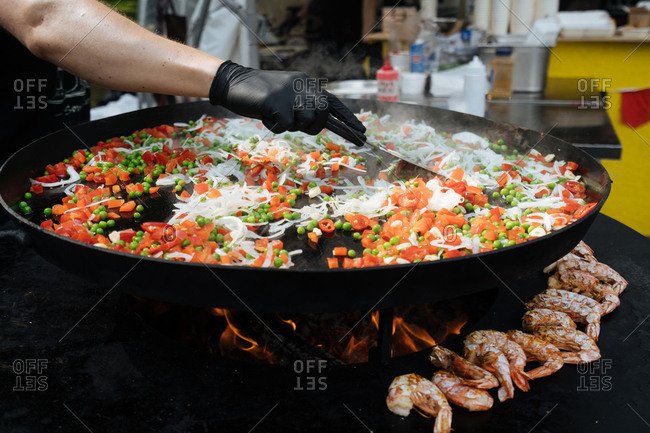 Chef preparing vegetables on a grill