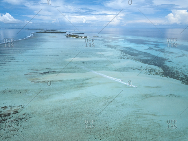 Aerial view of seascape against cloudy sky at Maldives