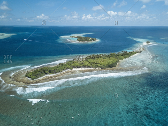 Aerial view of sea against blue sky during sunny day